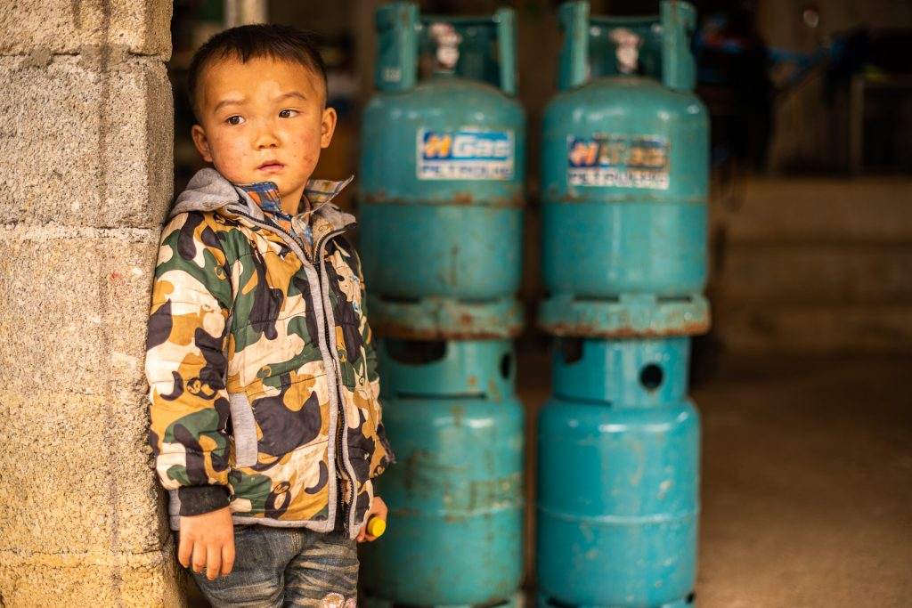 Vietnamese kid and gas bombs